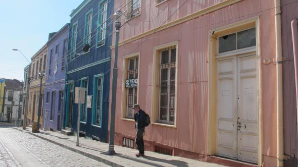 Most of the houses/buildings are painted in different colours.